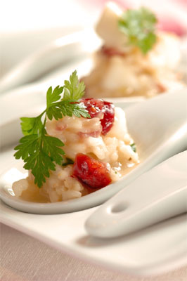 Risotto spoons with scallops, cranberries, parsley, lemon zest & chilli